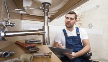 plumber-with-tablet-repairing-sink_23-2147772192-370x215 Home